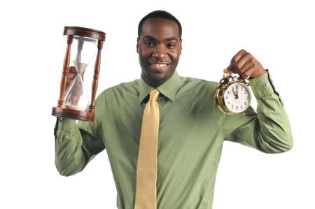 sand timer: Businessman holding a sand timer and a vintage clock isolated on a white background
