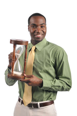 Businessman smiling and holding a sand timer isolated on a white background photo