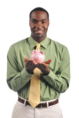 Businessman smiling and holding a piggy bank isolated on a white background photo