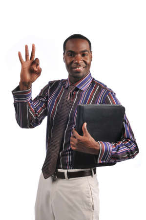African American businessman giving the OK sign and holding a portfolio photo