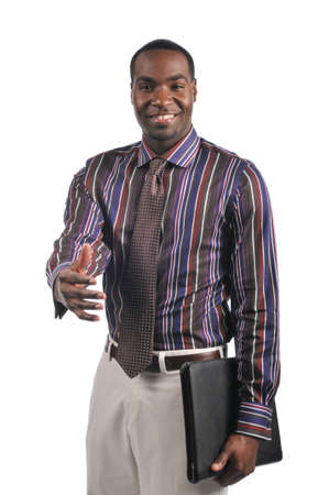 African American businessman extending a hand shake and holding a portfolio photo
