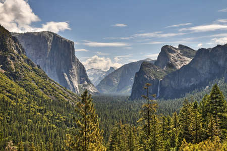 Yosemite Valley vista from Tunnel View showing the mountains and waterfalls photo