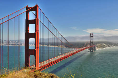 Golden Gate Bridge in San Francisco from overlook on sunny day photo