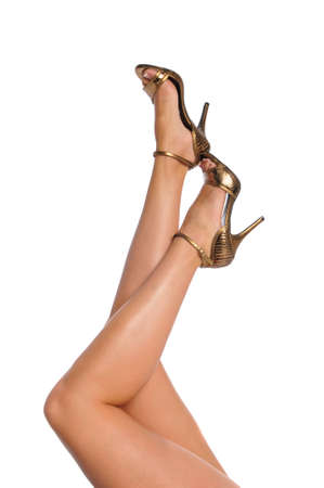 Legs with high heels isolated on a white background Stock Photo - 8042956