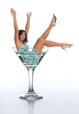 Young woman in a martini glass on a white background Stock Photo