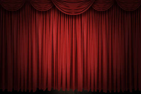 curtain theatre: Large red curtain stage opening with spot lights and dark background