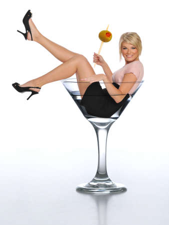 martini: Young blond in a martini glass holding an olive Stock Photo