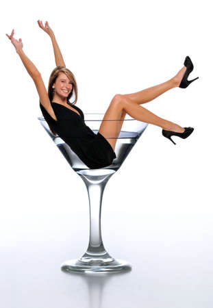 Young woman in a martini glass celebrating ans isolated on a neutral background