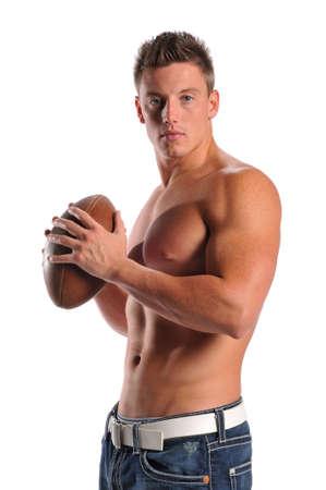 whithe: Muscular joven sosteniendo un bal�n de f�tbol aislado en un fondo de whithe