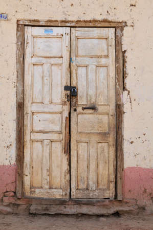 Old grungy door with textured wall and old lock photo