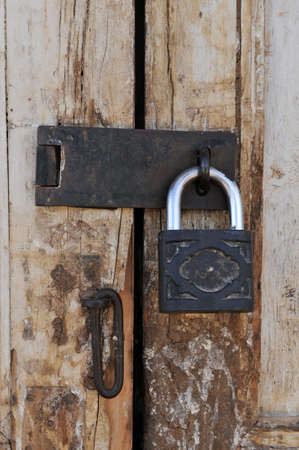 Old grungy door with vintage lock close up photo
