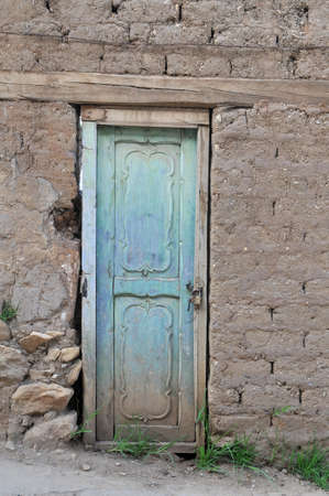 Old grungy door with textured walls photo