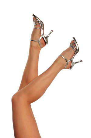 Woman's legs with high heels isolated on a white background Stock Photo - 8043050