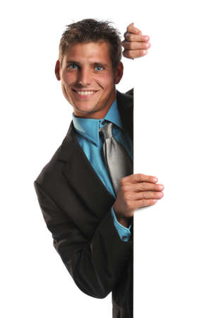 Young businessman holding a blank sign and smiling on a white background photo