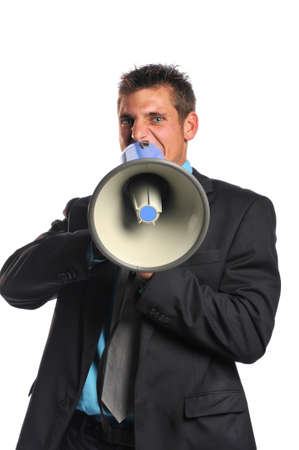 Young businessman with megaphone expressing unger isolated on a white background Stock Photo - 8055959