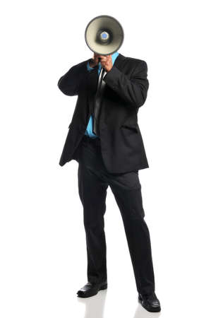 Businessman with megaphone standing and isolated on a white background Stock Photo - 8055931
