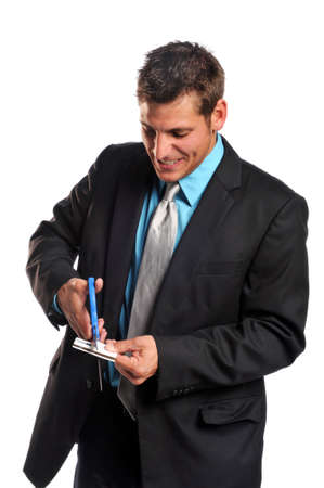 Businessman cutting credit card isolated on a white background photo
