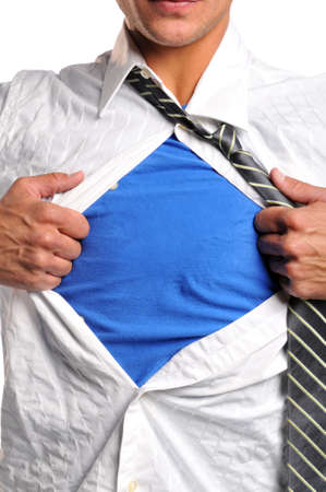 strong message: Businessman opening his shirt wearing a blue t-shirt undernith Stock Photo
