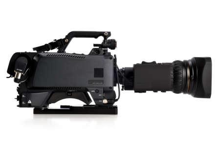 Professionele videocamera die juiste isolatad op een witte achtergrond onder ogen zien Stockfoto