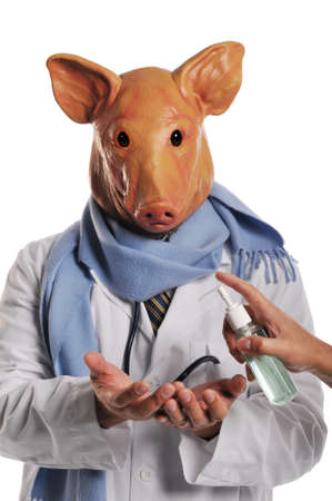 Swine Flu metaphore showind a doctor with pig's head getting hand sanitazer Stock Photo - 8132643