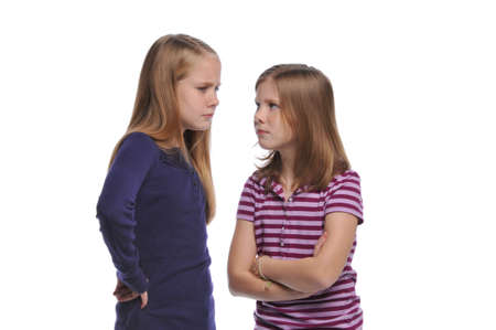 resolving: Two girl resolving a conflict isolated on a white background Stock Photo