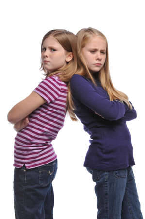 Two girl resolving a conflict isolated on a white background Imagens