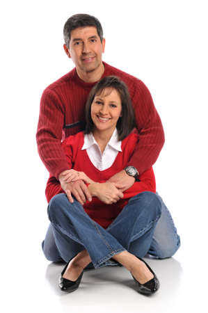 Middle age couple smiling isolated on a white background Stock Photo - 8166224