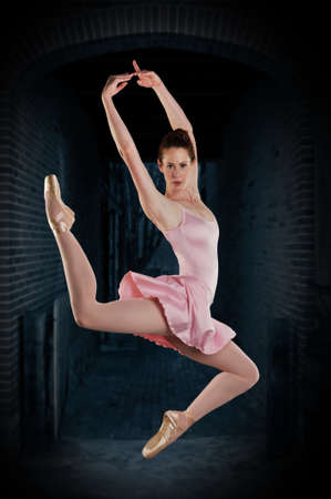 Ballerina performing against a grungy background photo