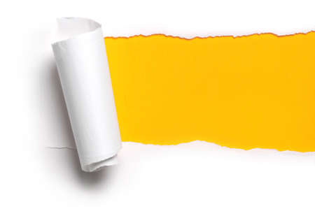 torn: ripped white paper against a yellow background