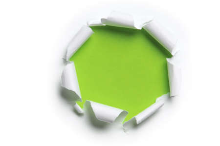 paper rip: ripped white paper against a green background