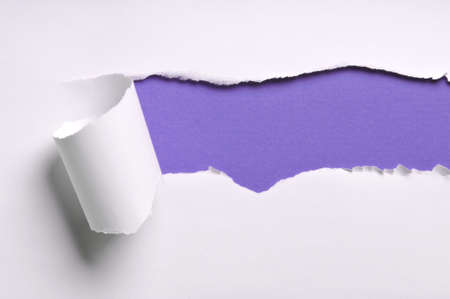 ripped white paper against a purple background photo