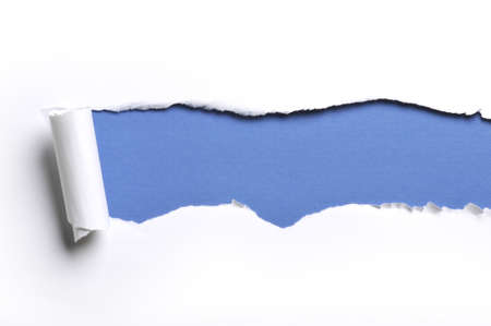 ripped white paper against a blue background