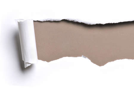 ripped white paper against a brown background Stock Photo - 8166489