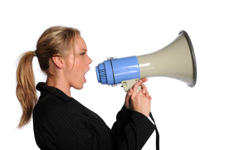 Young businesswoman screaming with a megaphone isolated on a white background photo