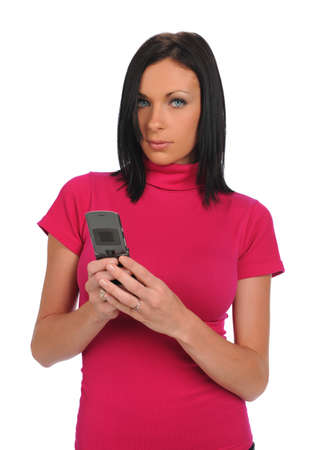 Young Woman with cell phone texting isolated on a white background photo