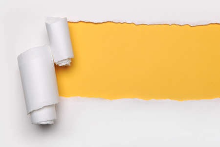 Ripped Paper with yellow harts shape and on a white background