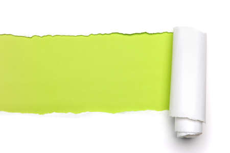 Torn Paper showing green background isolated on a white background Stock Photo