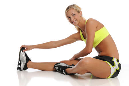 Young womna working out and streaching isolated on a white background Stock Photo