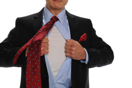 Businessman oepening his shirt as a metaphor for power isolated on white Stock Photo - 8295366
