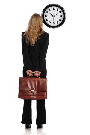 Geschäftsfrau, Blick auf eine Dollar-Uhr als ein Konzept, dass Zeit Geld ist Standard-Bild - 8295348