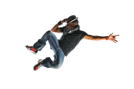 break: Hip Hop Dancer Jumping wearing a hat and isolated on a white background