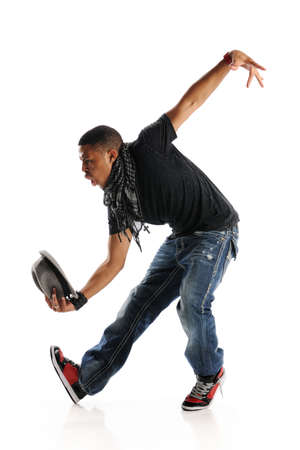 Hip Hop Style Dancer with Hat in his hand and isolated on a white background
