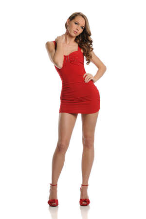 Young Blond Woman wearing a red dress isolated on a white background Stock Photo - 9210317