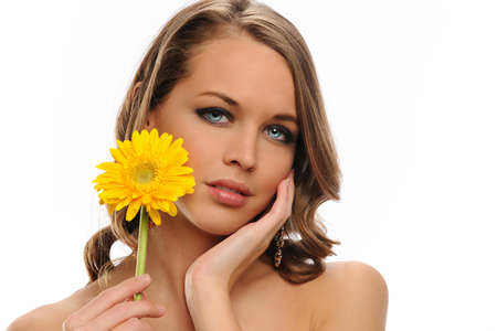 Young Woman portrait holding a yellow flower isolated on a white background Stock Photo - 9210328