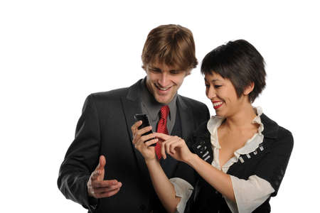 Couple looking at a  cell phone and smiling isolated on a white background photo