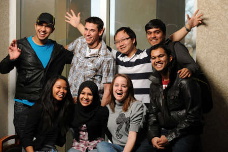 Very Diverse Group of Students smiling and having fun Stock Photo