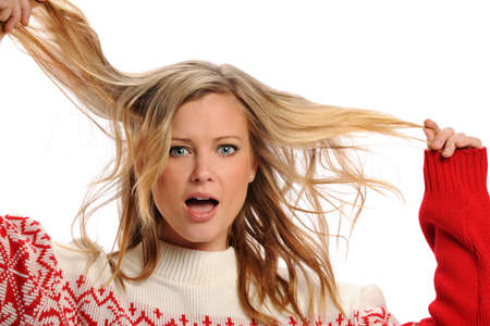 Young Blond Woman pulling her hair isolated on a white background photo