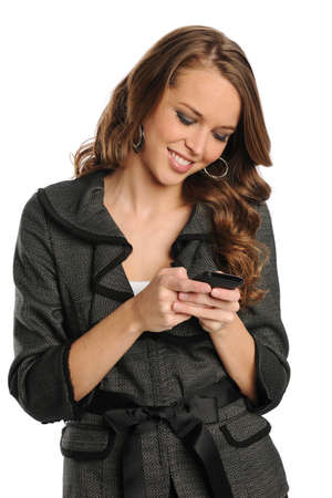 Young Businesswoman text messaging on the cell phone isolated on a white background photo