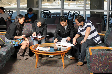 college building: Diverse group of students studing at the College campus Stock Photo