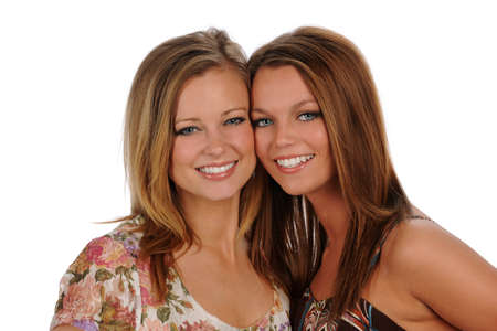 Two Young Sisters portrait smiling isolated on a white background 免版税图像